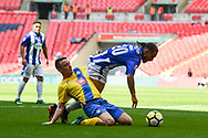 James Ward of Stockton Town (3) fouls Jordan Brown of Thatcham Town (20) and gives away a penalty during the FA Vase match between Stockton Town and Thatcham Town at Wembley Stadium, London, England on 20 May 2018. Picture by Stephen Wright
