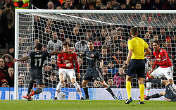 CSKA Moscow's Alan Dzagoev (centre) scores his side's first goal as the ball ricochets off his back following a shot from team-mate Coelho Vitinho during the UEFA Champions League match at Old Trafford, Manchester.