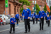 A young marcher chatting during the Orange March, Belfast, NI, 2021