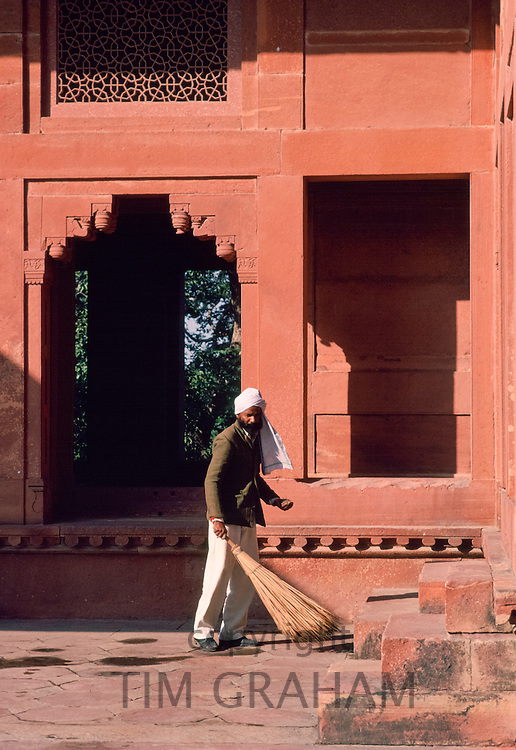 Cleaner at Fatehpur Sikri 17th Century city capital of Mughal Empire UNESCO WORLD HERITAGE site, Agra district, Uttar Pradesh, India