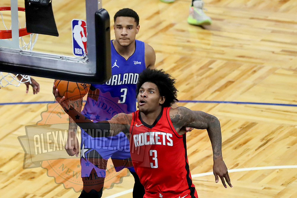 ORLANDO, FL - APRIL 18: Kevin Porter Jr. #3 of the Houston Rockets drives to the basket past Chuma Okeke #3 of the Orlando Magic during the second half at Amway Center on April 18, 2021 in Orlando, Florida. NOTE TO USER: User expressly acknowledges and agrees that, by downloading and or using this photograph, User is consenting to the terms and conditions of the Getty Images License Agreement. (Photo by Alex Menendez/Getty Images)*** Local Caption ***  Kevin Porter Jr.; Chuma Okeke