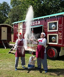 """Giffords Circus presents """"Xanadu"""" <br /> Produced by Nell Gifford  - Directed by Cal McCrystal<br /> At Chisiwck House and Park, London, Great Britain <br /> Press view <br /> 27th June 2019 <br /> <br /> <br /> The famous Clown Tweedy (left) practices performing the flour throwing routine at Giffords Circus <br /> <br /> Roll up, roll in to the stately pleasure-dome for miracles, song, symphony and enchantment. Musicians, horses, clowns and tumblers enfolded in this joyful paradise, with music loud and long - the Giffords Circus caravan will be taking to the road for a 2019 summer of love.<br /> <br /> <br /> It is midsummer 1973 in Hyde Park and the flower power movement is at its height. Hippies, hipsters, rock stars, musicians, wild women and global nomads with Shamanic horses gather to play, sing, dance, protest and perform. Policemen and a family of out-of-towners get caught up in the celebrations. Will they get in the groove? Nell Gifford builds a pleasure dome and Tweedy has a job in the kitchen as he thought everyone was talking about """"Flour Power"""". As evening approaches, the ever more chaotic event careers towards a joyful, transcendental finale. <br /> <br /> Photograph by Elliott Franks"""