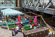 Las Iguanas outdoor cafe located alongside the Hungerford railway bridge at the Southbank Centre, on 5th August, in London, England.
