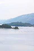 Oyster and shellfish shell fish farm beds in the Kanal Malog Stona straight by the Peljesac peninsula with mountains in the background Peljesac peninsula. Dalmatian Coast, Croatia, Europe.