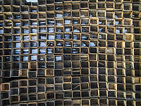 Abstract aerial view of wooden industrial boxes covered with snow.