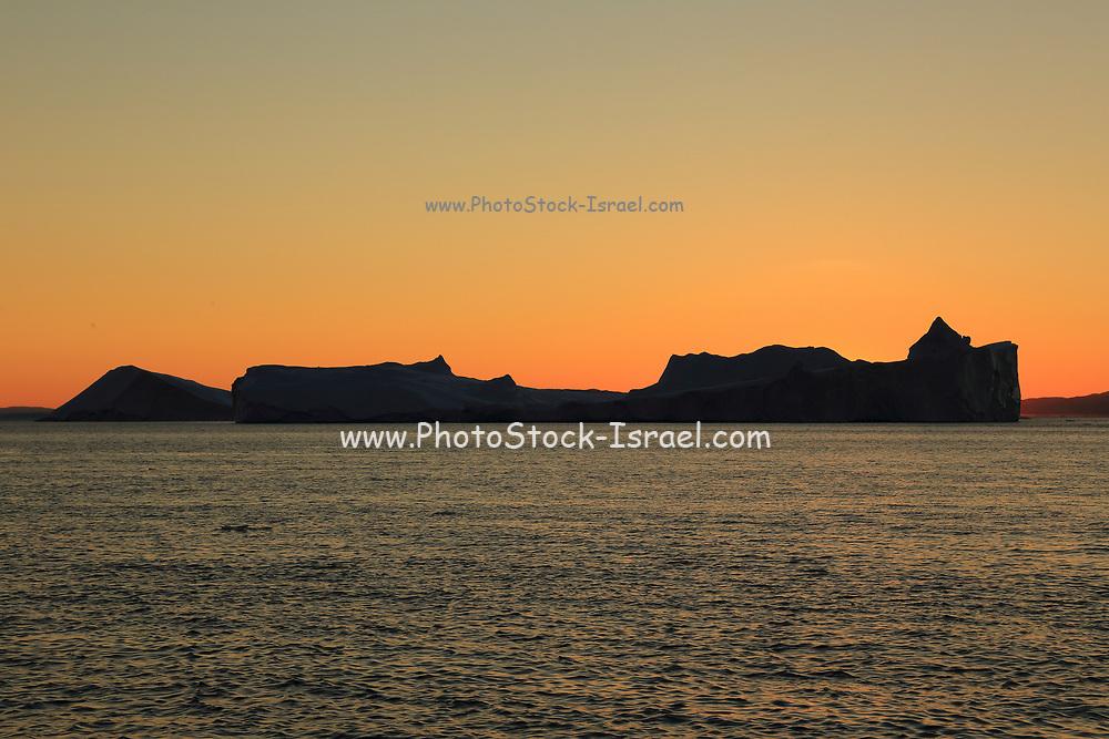 Icebergs from the icefjord, Ilulissat, Disko Bay, Greenland, Polar Regions at sunset