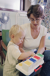 Mother playing with child on children's ward in hospital,
