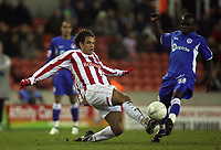 Photo: Paul Thomas.<br /> Stoke City v Millwall. The FA Cup. 05/01/2007.<br /> <br /> Darel Russell (L) of Stoke wins the basll ahead of Ali Fuseini.
