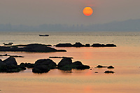 """Coast scenery at dusk, Yangma island, prefecture Yantai, Shandong, China. Yangma Island is situated by the Yellow Sea and it is called """"the pearl in the sea""""."""