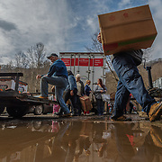 Volunteers carry orders to be filled and placed in cars at Paradise Island in Logan County, W.Va., on Thursday, February 21, 2019.