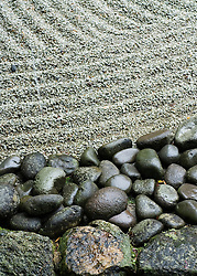 Detail of gravel and stones in traditional Japanese dry garden at Dazaifu Temple in Fukuoka Japan
