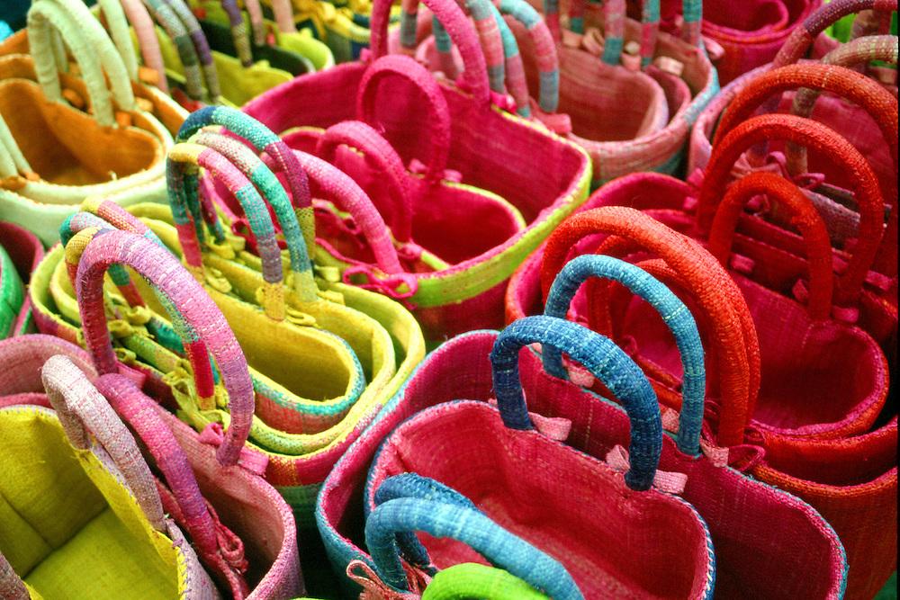 Multi-coloured straw baskets for sale, open air market, L'Isle sur la Sorgue, Provence France