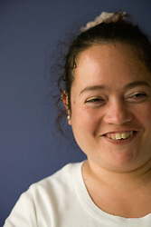 Portrait of day service user with learning disabilities laughing,