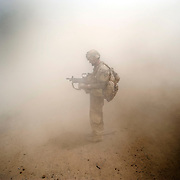 Standing in dust from improvised explosive device blast, Nakhonay, Panjwa'i District, Kandahar, Afghanistan. 2010<br /> 20 X 24 inch pigment print. <br /> Photo © Louie Palu<br /> FOR EXHIBITION REVIEWS ONLY. NO OTHER EDITORIAL USE PERMITTED.<br /> www.louiepalu.com