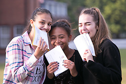 © Licensed to London News Pictures. 18/08/2016. Solihull School students receiving their A Level results earlier today. Just like biting Olympic medals, from left, Camani Lall, Lydia Stephens, Becky Timperley. Photo credit: Dave Warren/LNP