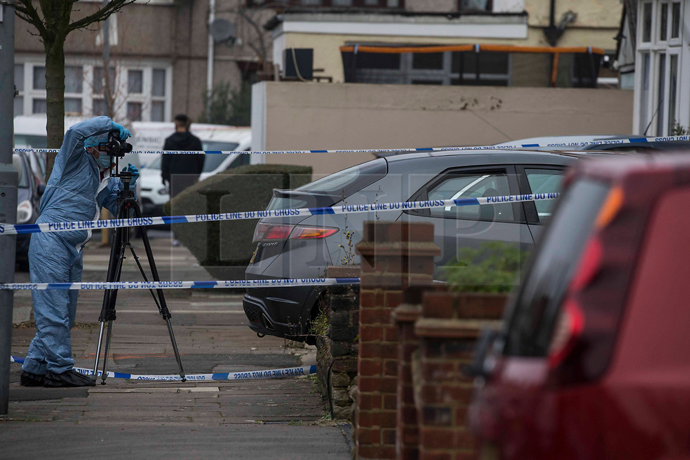 © Licensed to London News Pictures.10/01/2021, London, UK. Police and forensic officers gather evidence at the crime scene after two men were fatally injured in Ilford, east London. Met Police were called at 04:24 this morning to reports of a disturbance. Both victims were pronounced dead at the scene. Photo credit: Marcin Nowak/LNP