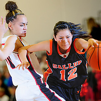 020213  Adron Gardner<br /> <br /> Gallup Bengal Kaylee Tsingine (12), right, pushes past  Grants Pirate Sydney Mares (10) in Grants Saturday.