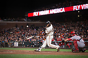 San Francisco Giants shortstop Brandon Crawford (35) makes contact with a Cincinnati Reds pitch at AT&T Park in San Francisco, California, on May 11, 2017. (Stan Olszewski/Special to S.F. Examiner)