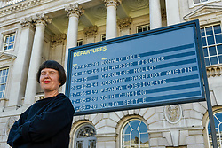 © Licensed to London News Pictures. 10/09/2020. LONDON, UK.  Davina Drummond, of Yara and Davina, poses in front of their work Arrivals + Departures, a major interactive installation in the courtyard of Somerset House.  The artwork allows the public to memorialise their names on the mechanical flipboards which are often seen at a railway station or airport and is on show until 10 October 2020.  Photo credit: Stephen Chung/LNP