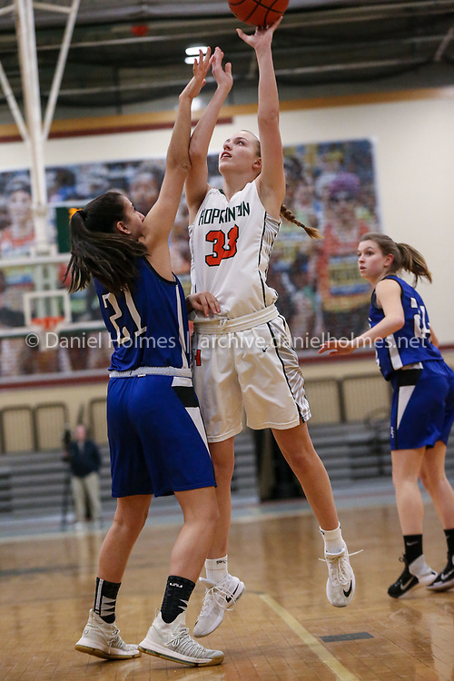 (2/8/19, HOPKINTON, MA) Hopkinton's Lexy Trendel photos for two points during the girls basketball game against Dover-Sherborn at Hopkinton High School on Friday. [Daily News and Wicked Local Photo/Dan Holmes]