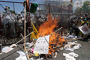 10 SEPTEMBER 2003 - CANCUN, QUINTANA ROO, MEXICO: Korean protestors opposed to the World Trade Organization start a bonfire at the fence separating the downtown area from the hotel zone in Cancun, Quintana Roo, Mexico during a protest against the WTO. Tens of thousands of people opposed to the WTO have come to this Mexican resort city to protest the 5th Ministerial meeting of the World Trade Organization. The WTO meetings are taking place in the hotel zone of Cancun, about 10 miles from the protestors.  PHOTO BY JACK KURTZ