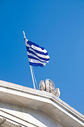 Greek Flag on the National Library of Greece, part of the architectural trilogy designed by Danish architect Theopil Hansen, Athens, Greece