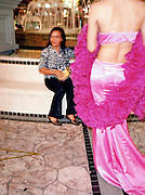 A ladyboy performer in a magenta ball gown.