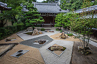 "Mirei Garden at Shinnyodo -  Three gardens are to be found at <br /> Shinnyodo Temple.  The first is the Nehan ""Nirvana"" garden and was built in the classic karesansui rock garden style in 1988. It uses the shakkei borrowed landscape technique to include Mt. Hiei in its design. The second garden was designed by Shigemori Chisao - Its modern geometrical style is similar in design to his father renowned landscape architect and garden designer Shigemori Mirei. The third is a small tea garden, with its own tea ceremony hut."