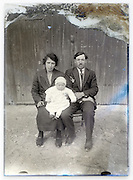 eroding glass plate with young parents and their baby child