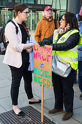 London, UK. 10th April 2019. Laura Pidcock (l), Shadow Minister for Business Energy & Industrial Strategy, joins outsourced workers belonging to the Public & Commercial Services (PCS) union standing on a picket line outside their place of work at the Government Department for Business, Energy and Industrial Strategy (BEIS) during strike action to demand a real living wage of £10.55 per hour (the Living Wage Foundation's London Living Wage) and terms and conditions comparable with civil servants who work in the same department.