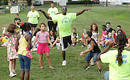 Middletown, New York - A counselor and children from the Middletown YMCA summer camp perform during a talent show for parents and other campers on August 17, 2010.