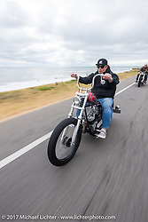 "Chris Wade riding his custom 1953 Harley-Davidson Panhead ""Supafly"" north on AIA toward Flagler Beach during Daytona Beach Bike Week. FL. USA. Tuesday, March 14, 2017. Photography ©2017 Michael Lichter."