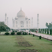 """Early morning sunrise walk at the <br /> Taj Mahal, meaning """"Crown of the Palaces"""", an ivory-white marble mausoleum on the south bank of the Yamuna river in the city of Agra."""