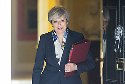 June 21, 2017 - London, London, UK - London UK. Prime minister Theresa May leaves number 10 this morning heading to Parliament for the Queens speech marking the opening of Parliament. This years speech is expected to be overshadowed by 'day of rage protests' by left wing campaigners. (Credit Image: © Andrew Mccaren/London News Pictures via ZUMA Wire)