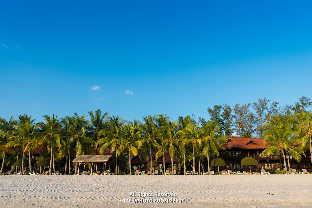 Meritus Pelangi hotel and palm trees at Cenang beach, Langkawi, Malaysia