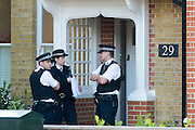 © Licensed to London News Pictures. 23/04/2014. New Malden, UK The scene in New Malden where a man has been arrested after the discovery of three bodies of children in a house overnight. Photo credit : Stephen Simpson/LNP