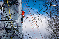 The ice is being sprayed against an old high-voltage pylon that NUON donated years ago to the climbing center near the Rijnhal. Making such an ice wall of 15 meters high, the highest ever in the Netherlands, requires a lot of patience and attention, but it really comes about drop by drop. Mountain climbers train on a vertical ice wall made in an electricity mast on february 12, 2021 in Arnhem