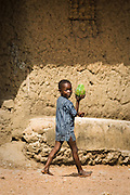 A boy walks by carrying a papaya in the village of Mabanta, Sierra Leone on Friday February 27, 2009.