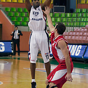 Efes Pilsen's Bootsy THORNTON (L) during their Turkish Basketball league Play Off first leg match Efes Pilsen between Erdemir at the Ayhan Sahenk Arena in Istanbul Turkey on Thursday 29 April 2010. Photo by Aykut AKICI/TURKPIX