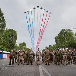 """Célébration du 14 juillet, fête nationale française, défilé militaire intitulé en 2021 """"Gagner l'avenir"""" mettant en lumière la volonté des Français de surpasser les difficultés liées à la crise sanitaire ainsi que le rôle d'anticipation des armées qui, grâce à la haute technologie, sont capables de prévenir les crises et d'imaginer les combats du futur.<br /> L'année 2021 est aussi celle de la première participation au défilé parisien de l'école militaire des aspirants de Coëtquidan (EMAC), de l'École nationale supérieure de techniques avancées de Brest (ENSTA Bretagne) et des forces de police municipale représentées par la PM de Nice. Préparatifs et défilé militaire sur les Champs Elysées devant le président de la République.<br /> <br /> Le défilé du 14 juillet 2021 met à l'honneur la task force Takuba. Composée de forces spéciales et conventionnelles de huit pays européens (Belgique, Estonie, France, Italie, Pays-Bas, Portugal, République Tchèque et Suède), elle est déployée au Mali dans le cadre de l'opération BARKHANE.<br /> <br /> Juillet 2021/ Paris (75) / FRANCE Voir le reportage complet (130 photos) https://sandrachenugodefroy.photoshelter.com/gallery/2021-07-Defile-du-14-juillet-2021-Complet/G0000MptDQJGDgOQ/1/C0000yuz5WpdBLSQ"""