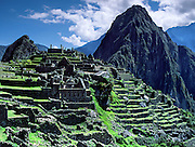 """Machu Picchu is a magnificent Inca archeological site in the Cordillera Vilcabamba, Andes mountains, Peru, South America. Machu Picchu was built around 1450 AD as an estate for the Inca emperor Pachacuti (14381472). Spaniards passed in the river valley below but never discovered Machu Picchu during their conquest of the Incas 1532-1572. The outside world was unaware of the """"Lost City of the Incas"""" until revealed by American historian Hiram Bingham in 1911. Machu Picchu perches at 2430 meters elevation (7970 feet) on a well defended ridge 450 meters (1480 ft) above a loop of the Urubamba/Vilcanota River ( Sacred Valley of the Incas). UNESCO honored the Historic Sanctuary of Machu Picchu on the World Heritage List in 1983."""