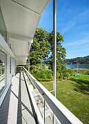long balcony of a villa on the lake, park view