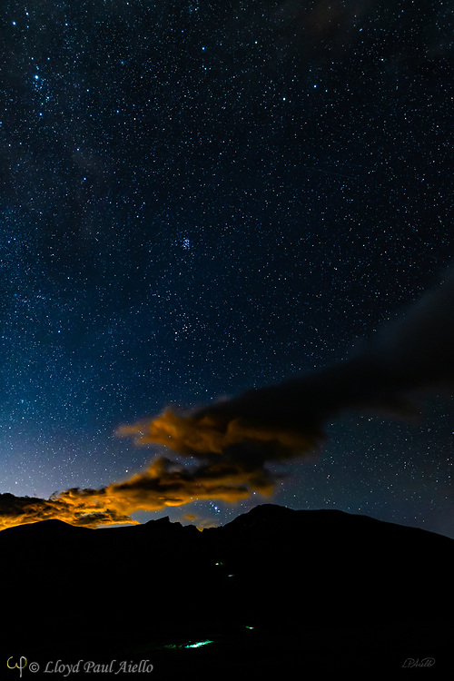 The headlamps of four mountaineering groups are seen ascending Mount Bierstadt in the predawn light under a star-filled Colorado sky (3:30am).  Mount Bierstadt at 14,068 feet (4287 m) was first climbed in 1863 and is the 38th tallest peak in Colorado and the 44th tallest in the continental United States.  Groups typically begin their ascent in the early morning so as to complete the 6.9 mile trail and be off the mountain before the danger of afternoon thunderstorms common in this area.