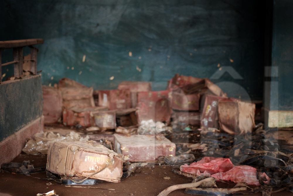 Leather boxes and film strips lay on the ground int the abandoned cinema of Bouasavanh, Vientiane, Laos, Asia