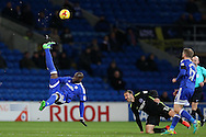 Sol Bamba of Cardiff city sets up an attack with an overhead kick as Brighton's Glenn Murray ® looks on.   EFL Skybet championship match, Cardiff city v Brighton & Hove Albion at the Cardiff city stadium in Cardiff, South Wales on Saturday 3rd December 2016.<br /> pic by Andrew Orchard, Andrew Orchard sports photography.