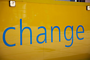 "Yellow oarding sign with the word ""Change"" written in blue letters."