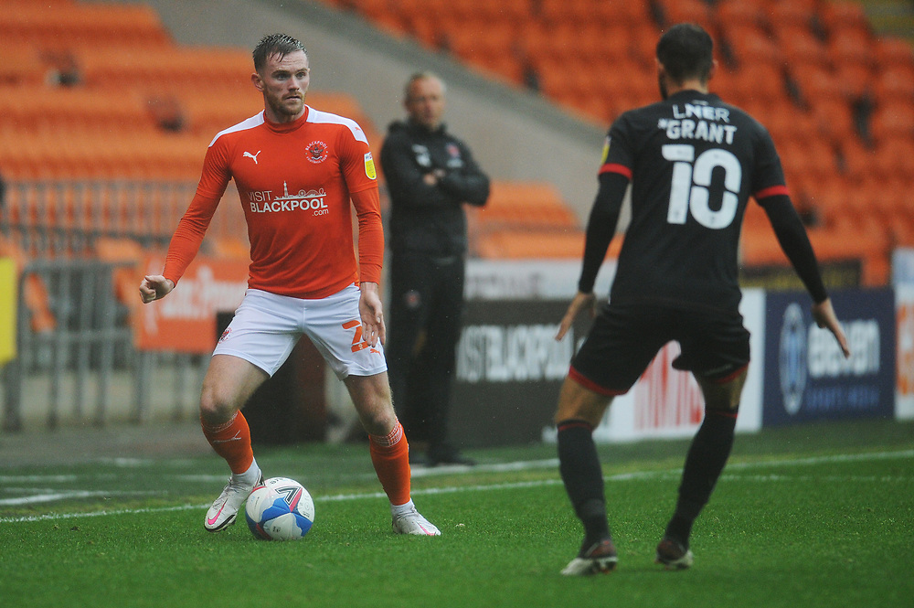 Blackpool's Oliver Turton under pressure from Lincoln City's Jorge Grant<br /> <br /> Photographer Kevin Barnes/CameraSport<br /> <br /> The EFL Sky Bet League One - Blackpool v Lincoln City - Saturday 3rd October 2020 - Bloomfield Road - Blackpool<br /> <br /> World Copyright © 2020 CameraSport. All rights reserved. 43 Linden Ave. Countesthorpe. Leicester. England. LE8 5PG - Tel: +44 (0) 116 277 4147 - admin@camerasport.com - www.camerasport.com