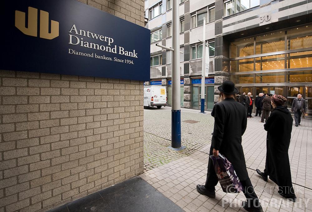 Pedestrians and diamond merchants walk past the Antwerp Diamond Bank on Hoveniersstraat, in the heart of the diamond district, in Antwerp, Belgium, on Thursday, Oct. 22, 2009. (Photo © Jock Fistick)