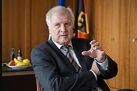 20 JUN 2018, BERLIN/GERMANY:<br /> Horst Seehofer, CSU, Bundesinnenminister, waehrend einem Interview, in seinem Buero, Bundesministerium des Inneren<br /> IMAGE: 20180620-02-036<br /> KEYWORDS: Büro