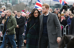 Prince Harry and Meghan Markle during a walkabout on the esplanade at Edinburgh Castle, during a visit to Scotland.